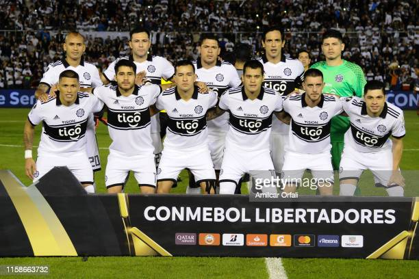 Players of Olimpia pose before a round of sixteen second leg match between Olimpia and LDU Quito as part of Copa CONMEBOL Libertadores 2019 at...