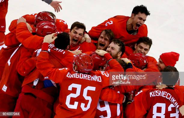 Players of Olympic Athlete from Russia celebrate winning the gold medal following the Men's Ice Hockey Gold Medal match between Germany and Olympic...
