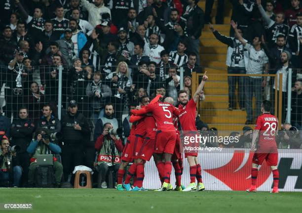 Players of Olympique Lyonnais celebrate after scoring during the UEFA Europa League quarter final second match between Besiktas and Olympique...