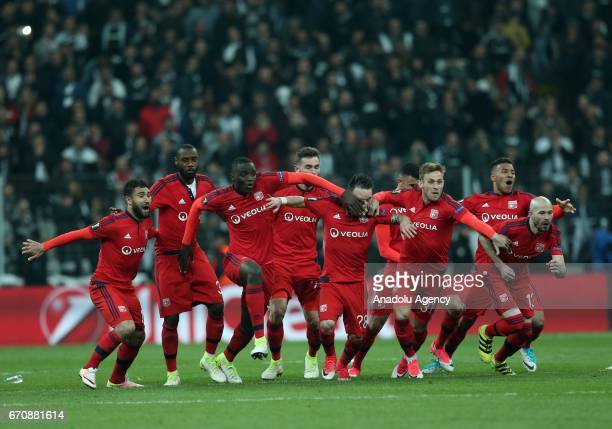 Players of Olympique Lyonnais celebrate after winning the penalty shootout against Besiktas during the UEFA Europa League quarter final second match...