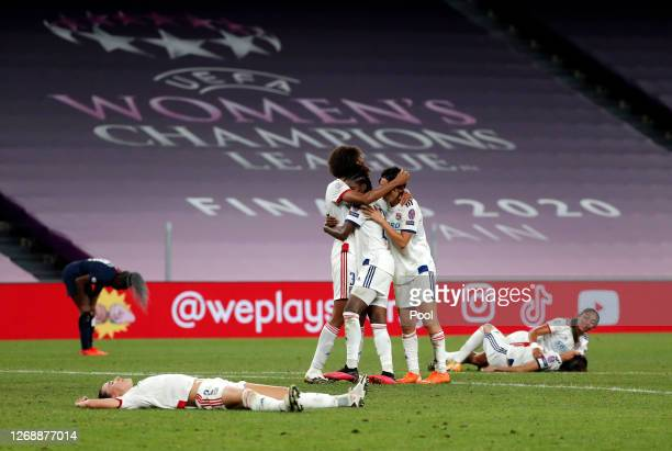 Players of Olympique Lyonnais celebrate following their sides victory in the UEFA Women's Champions League Semi Final between Paris Saint-Germain and...