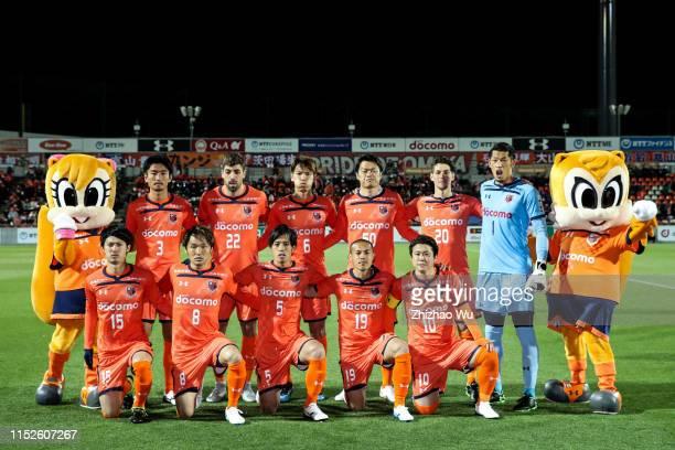 Players of Omiya Ardija line up for team photos prior to the J.League J2 match between Omiya Ardija v Fagiano Okayama at Nack 5 Stadium Omiya on...