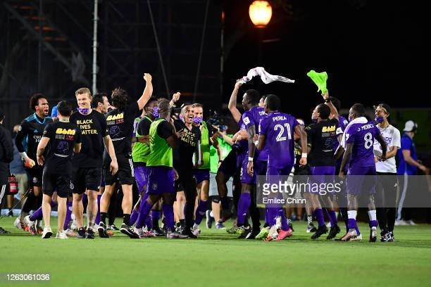 Players of Orlando City celebrate their victory after a quarter final match of MLS Is Back Tournament between over Los Angeles FC at ESPN Wide World...