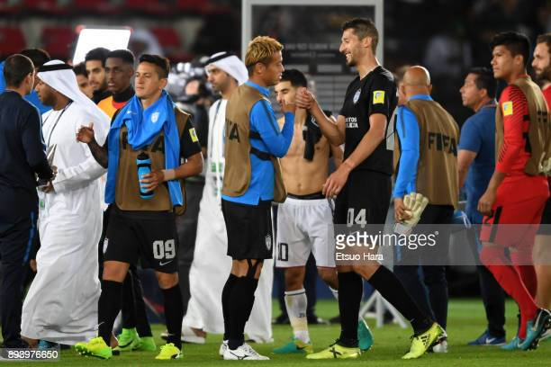 Players of Pachuca celebrate thier side's 41 victory after the FIFA Club World Cup UAE 2017 third place play off match between Al Jazira and CF...