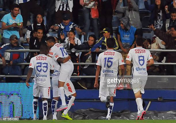 Players of Pachuca celebrates a goal against Tijuana during their Mexican Apertura tournament football match at the Hidalgo stadium on July 25 2015...