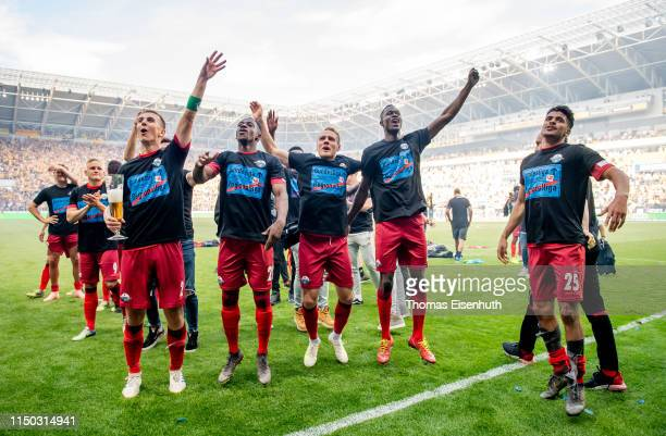 Players of Paderborn celebrate after the Second Bundesliga match between SG Dynamo Dresden and SC Paderborn 07 at RudolfHarbigStadion on May 19 2019...