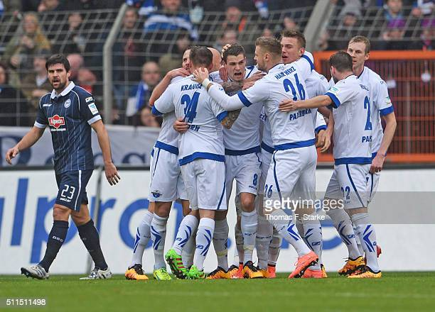Players of Paderborn celebrate their teams first goal while Florian Dick of Bielefeld looks dejected during the Second Bundesliga match between...
