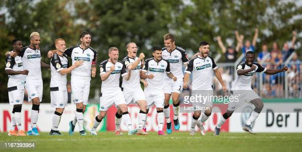 Players of Paderborn celebrates during the penalty shoot out during the DFB Cup first round match between SV Roedinghausen and SC Paderborn 07 at...