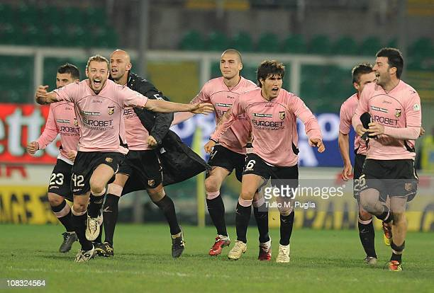 Players of palermo celebrate after beating Parma on penalties during the Tim Cup match between US Citta di Palermo and Parma FC at Stadio Renzo...
