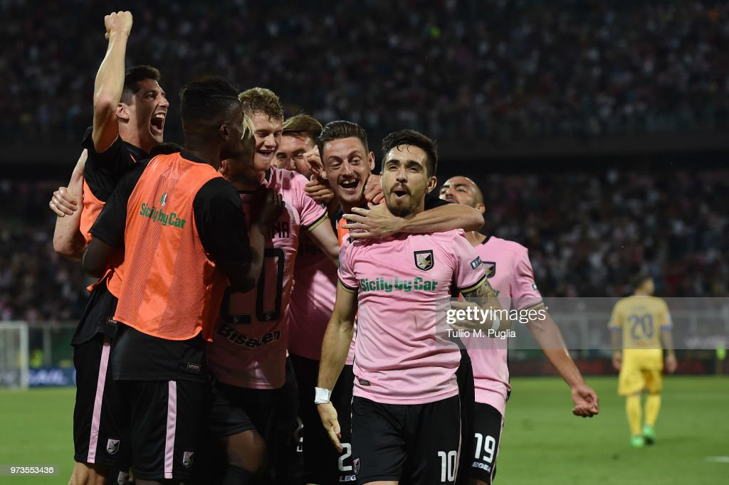 Players of Palermo celebrate after Emanuele Terranova of Frosinone scoring an own goal during the serie B playoff match final between US Citta di Palermo and Frosinone Calcio at Stadio Renzo Barbera on June 13, 2018 in Palermo, Italy.