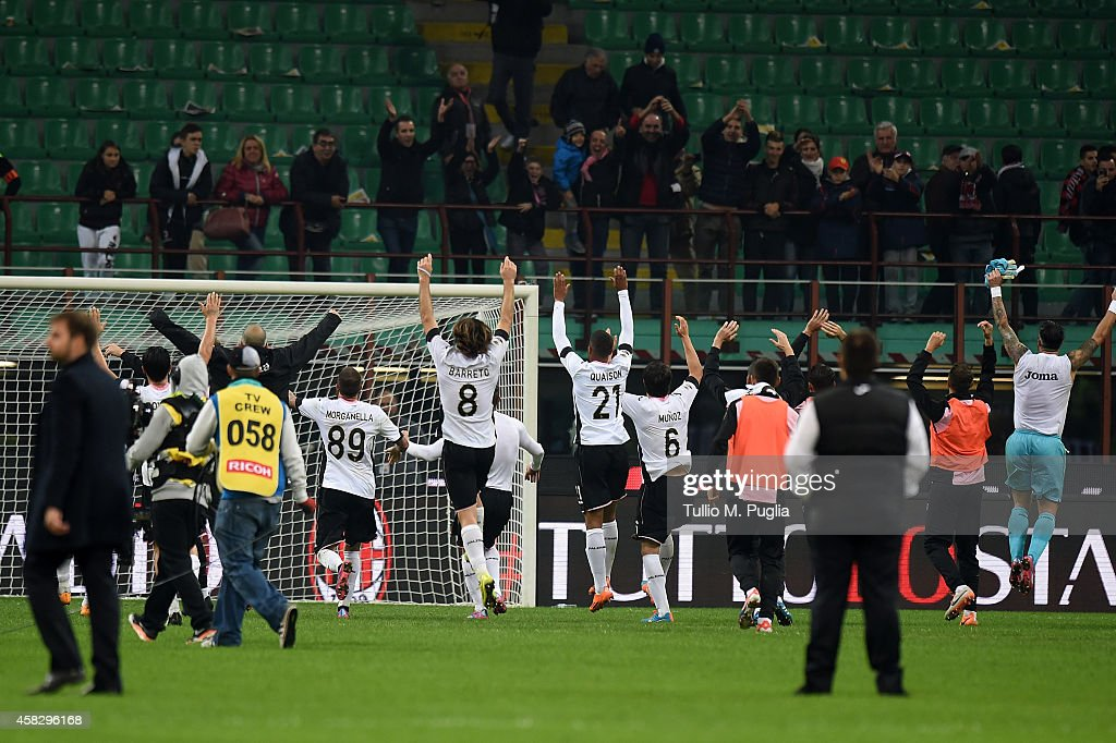 Players of Palermo celebrate after winning the Serie A match between AC Milan and US Citta di Palermo at Stadio Giuseppe Meazza on November 2, 2014 in Milan, Italy.