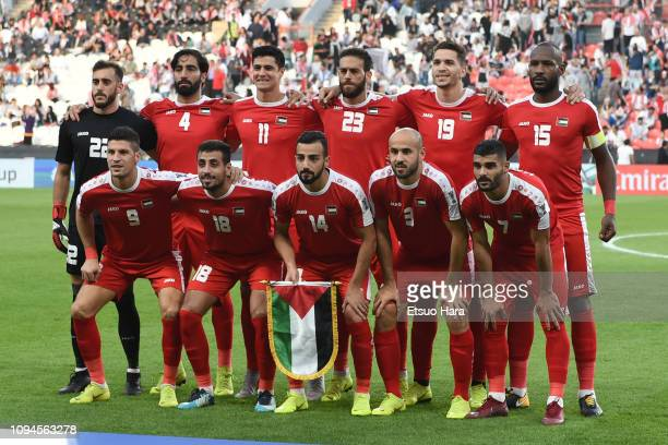 Players of Palestine line up for the team photo prior to the AFC Asian Cup Group B match between Palestine and Jordan at Mohammed Bin Zayed Stadium...