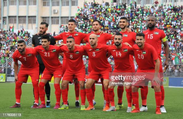 Players of Palestine pose for a photo ahead of the 2020 FIFA World Cup Asia qualifiers group match between Palestine and Saudi Arabia at Al-Husseini...