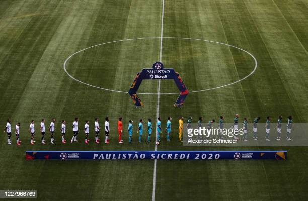 Players of Palmeiras and Corinthians line up during the National Anthem before the match between Corinthians and Palmeiras as part of the State...