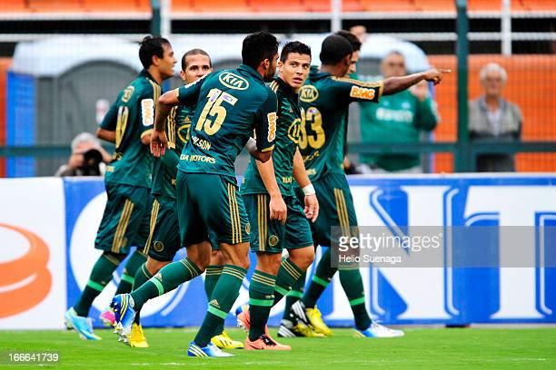 Players of Palmeiras celebrate a goal against Guarani during a match between Palmeiras and Guarani as part of Paulista Championship 2013 at Pacaembu...