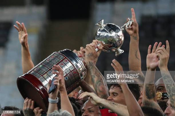Players of Palmeiras celebrate with the trophy after winning the Copa Libertadores football tournament by defeating Santos 1-0 in the all-Brazilian...