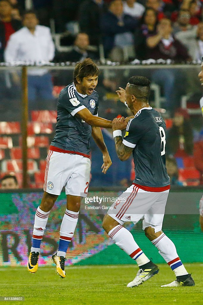 Players of Paraguay celebrate after Arturo Vidal of Chile (not in frame) scored an own goal during a match between Chile and Paraguay as a part of FIFA 2018 World Cup Qualifier at Monumental Stadium on August 31, 2017, in Santiago, Chile.