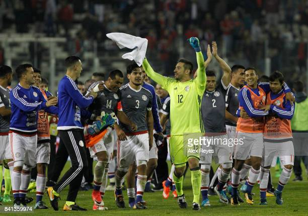 Players of Paraguay celebrate after defeating Chile in a match between Chile and Paraguay as part of FIFA 2018 World Cup Qualifiers at Monumental...