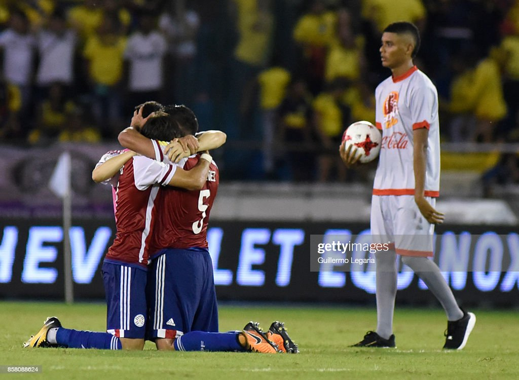 Players of Paraguay celebrate after winning a match between Colombia and Paraguay as part of FIFA 2018 World Cup Qualifiers at Metropolitano Roberto Melendez Stadium on October 05, 2017 in Barranquilla, Colombia.
