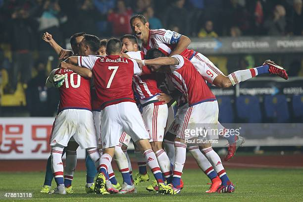 Players of Paraguay celebrate after winning the 2015 Copa America Chile quarter final match between Brazil and Paraguay at Ester Roa Rebolledo...