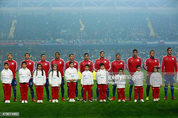 Players of Paraguay sing their national anthem prior to the 2015 Copa America Chile Semi Final match between Argentina and Paraguay at Ester Roa...