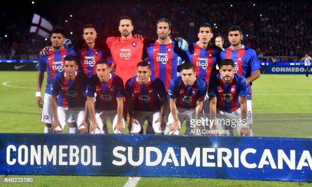 Players of Paraguay's Cerro Porteno pose for pictures before their Copa Sudamericana football tournament match against Colombia's Junior in Asuncion...