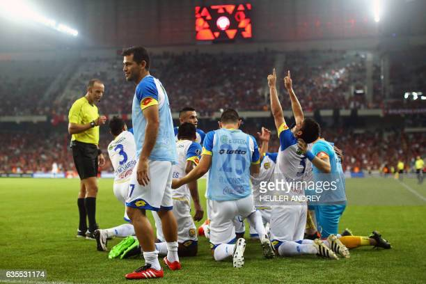 Players of Paraguay's Deportivo Capiata celebrate a goal scored in a match with Brazil's Atletico Paranaense during their Libertadores Cup football...