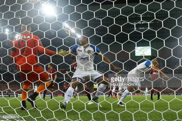 Players of Paraguay's Deportivo Capiata celebrate the third goal scored in a match with Brazil's Atletico Paranaense during their Libertadores Cup...