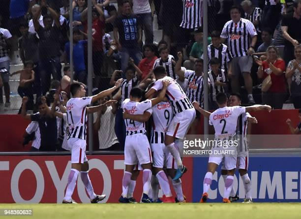 Players of Paraguay's Libertad celebrate after scoring against Uruguay's Penarol during their 2018 Libertadores Cup football match at the Nicolas...