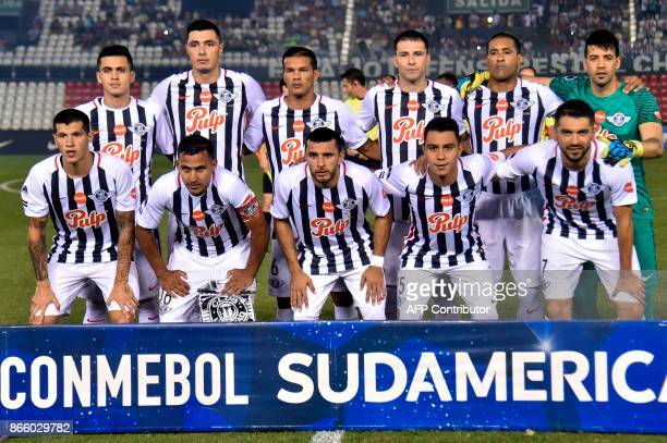 Players of Paraguay's Libertad pose for pictures before the start of their Sudamericana Cup quarterfinal football match against Argentina's Racing at...