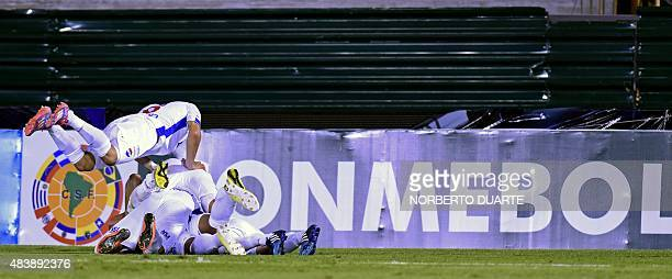 Players of Paraguay's Nacional celebrate after scoring against Chile's Universidad Concepcion during their Copa Sudamericana football match at the...