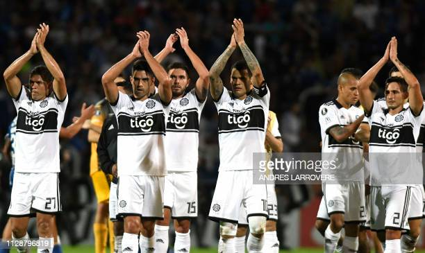 Players of Paraguay's Olimpia acknowledge their fans after tying 00 with Argentina's Godoy Cruz in their Copa Libertadores Group C football match at...