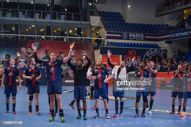 Players of Paris Saint Germain celebrate during the Lidl Starligue match between Paris Saint Germain and Pays d'Aix Universite Club at Stade Pierre...