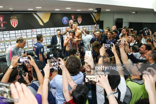 Players of Paris Saint Germain celebrate the champion at press conference room after the match between Paris Saint Germain and Monaco at Shenzhen...