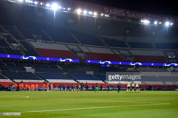 Players of Paris Saint-Germain and Istanbul Basaksehir line up in support of Pierre Achille Webo and against racism before the UEFA Champions League...