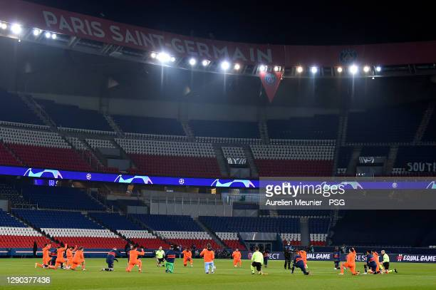 Players of Paris Saint-Germain and Istanbul Basaksehir take a knee in support of Pierre Achille Webo and against racism before the UEFA Champions...
