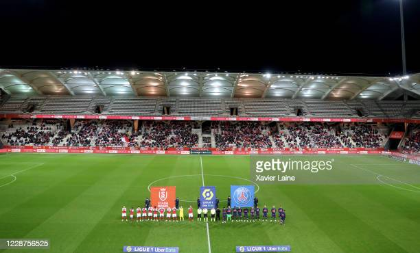 Players of Paris Saint-Germain and Stade Reims enter the field before the Ligue 1 match between Stade Reims and Paris Saint-Germain at Stade Auguste...
