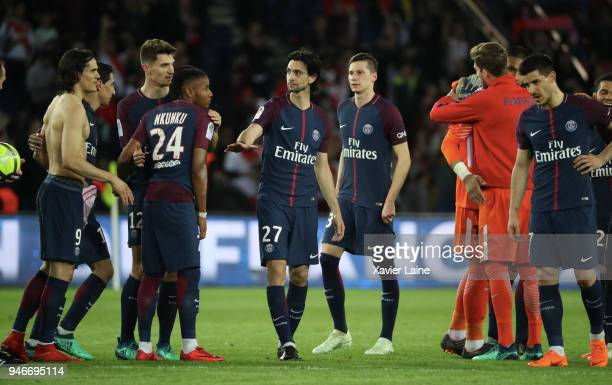 Players of Paris SaintGermain celebrate the championship victory after the Ligue 1 match between Paris Saint Germain and AS Monaco at Parc des...