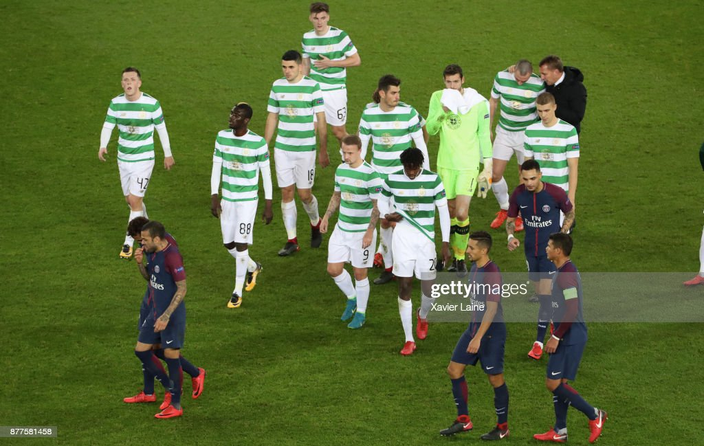 Players of Paris Saint-Germain celebrate the victory and Players of Celtics Glasgow are disapointed after the UEFA Champions League group B match between Paris Saint-Germain and Celtic Glasgow at Parc des Princes on November 22, 2017 in Paris, France.
