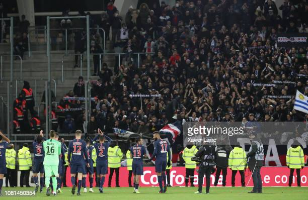 Players of Paris SaintGermain celebrate the victory with her fans after the Ligue 1 match between Amiens SC and Paris Saint Germain at Stade de la...