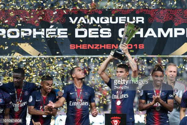 Players of Paris SaintGermain celebrate with trophy after winning the French Trophy of Champions football match between AS Monaco and Paris...