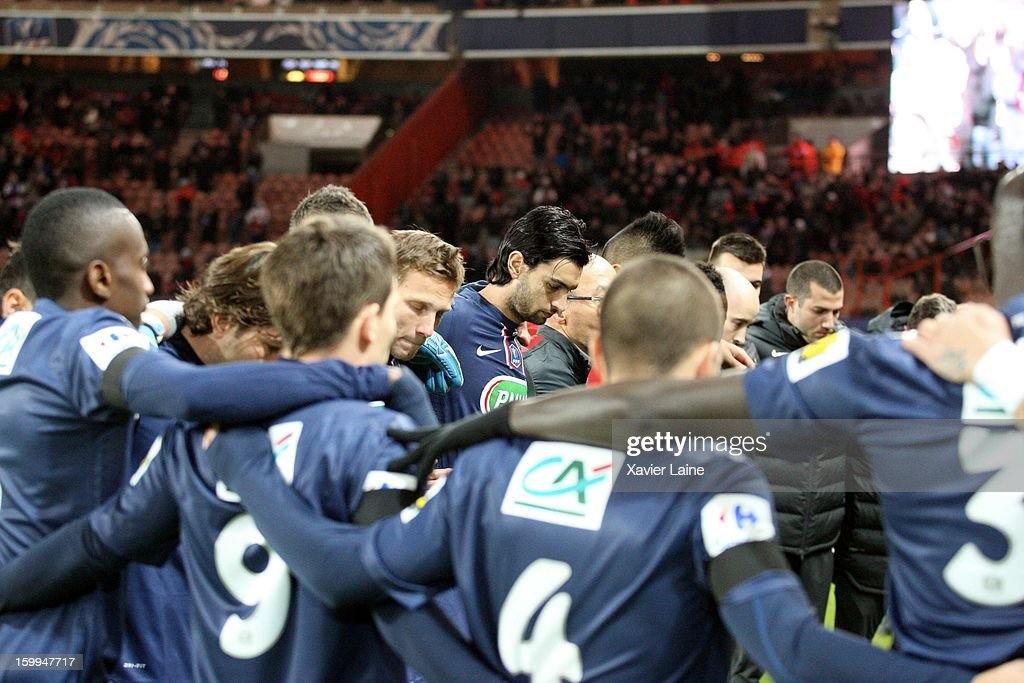 Players of Paris Saint-Germain FC respect a minute of silence before the French Cup between Paris Saint-Germain FC and Toulouse FC, at Parc des Princes on January 23, 2013 in Paris, France.