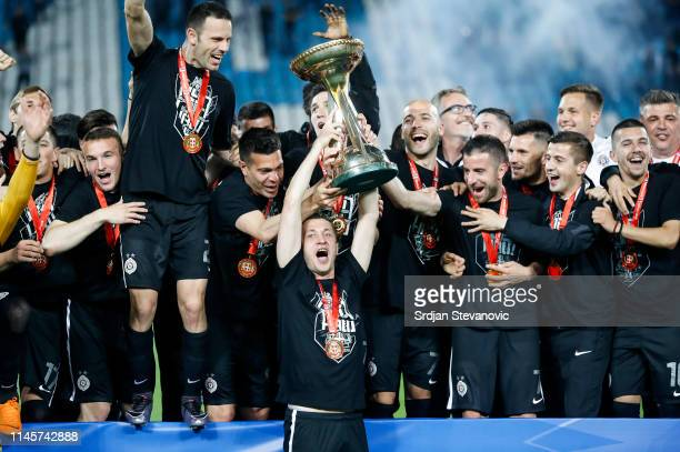 Players of Partizan celebrate with the trophy after winning the Serbian Cup Final match between FK Crvena Zvezda and FK Partizan at stadium Rajko...