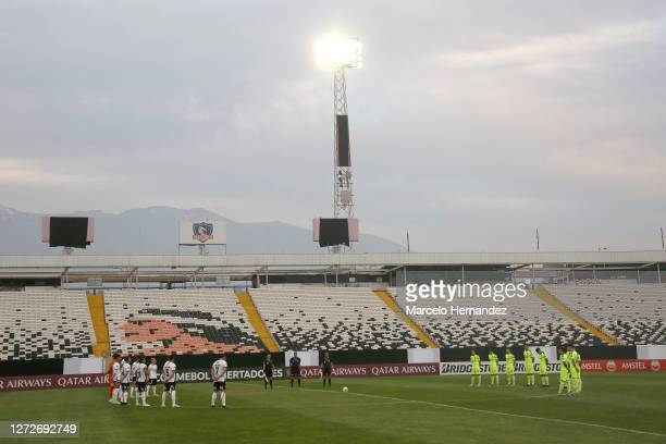 Players of Peñarol and Colo-Colo observe a minute of silence before a group C match between Colo Colo and Peñarol as part of Copa CONMEBOL...