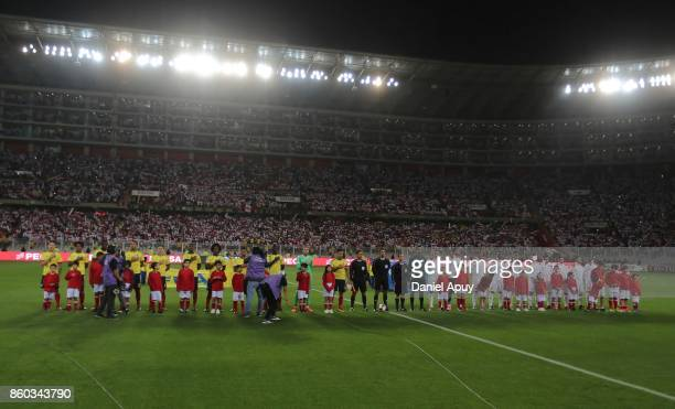Players of Peru and Colombia line up prior to a match between Peru and Colombia as part of FIFA 2018 World Cup Qualifiers at Monumental Stadium on...