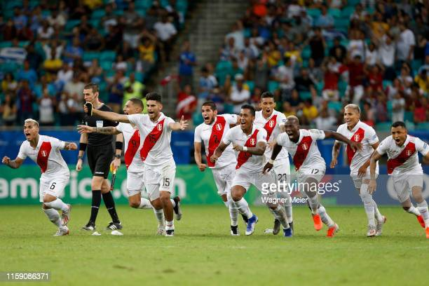 Players of Peru celebrate after winning during a penalty shootout after the Copa America Brazil 2019 quarterfinal match between Uruguay and Peru at...