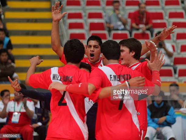 Players of Peru celebrate during a match against Chile in Volleyball event as part of the XVII Bolivarian Games Trujillo 2013 at Gran Chimœ Stadium...