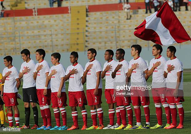 Players of Peru sing their national anthem before the football third place match between Peru and Guatemala as part of the XVII Bolivarian Games...
