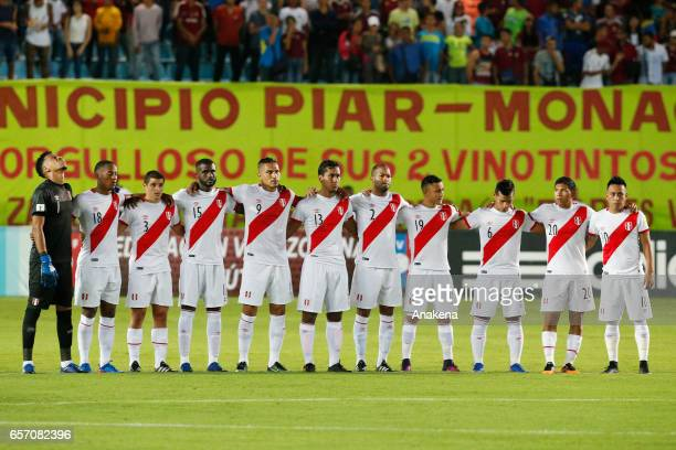Players of Peru stand during a minute of silence for the victims of natural disasters prior a match between Venezuela and Peru as part of FIFA 2018...