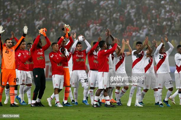 Players of Peru wave to the fans after the international friendly match between Peru and Scotland at Estadio Nacional de Lima on May 29 2018 in Lima...